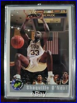 Shaquille o'neal rookie cards in wooden plaque. All cards are in mint condition